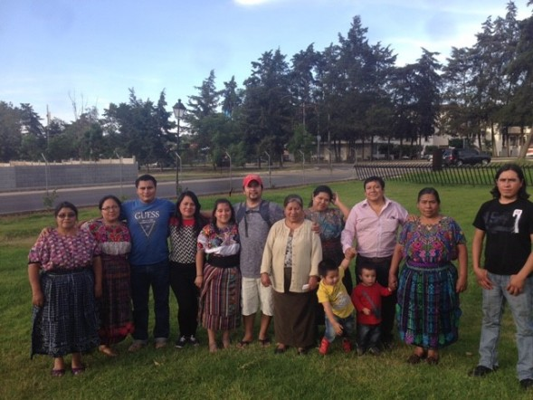 Carlos (in the red hat) with his family in Guatemala.